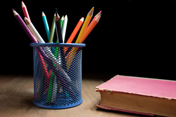 Colored pencils and book