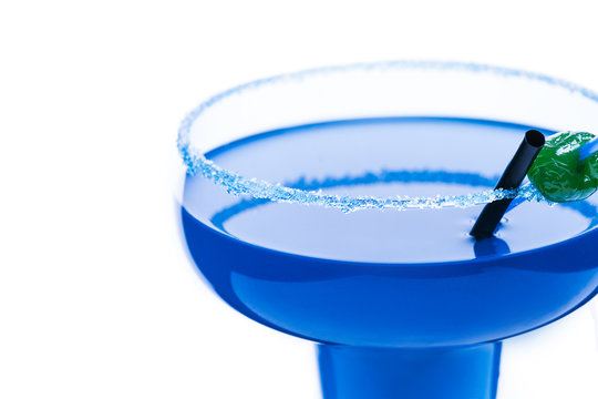 Cocktail blue lagoon on a white background.With a straw and candy . Alcoholic cocktail