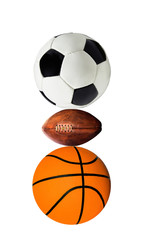 group of sports balls on a white