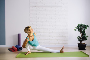 An attractive young woman doing a yoga pose for balance and stretching. Healthy concept