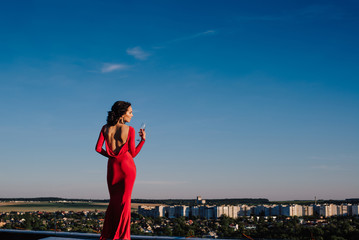 young beautiful brunette woman in a red dress