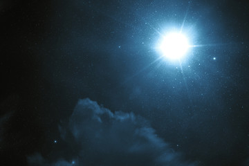 Tragic night sky with a full moon and shining stars
