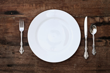Place setting of a dining set over rustic background