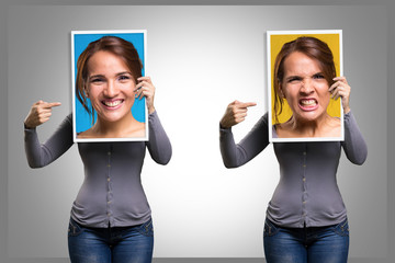 Girl holding a picture of her face happy and angry