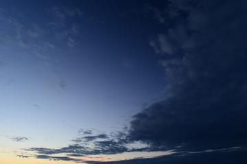 Dark blue cloud in the blue summer sky nightfall
