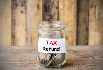 Text for TAX Refund, concept money in the glass