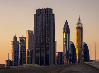 Amazing tallest skyscrapers in Sheikh Zayed road area during beautiful sunset. Downtown summer day. , Downtown, Dubai, United Arab Emirates.
