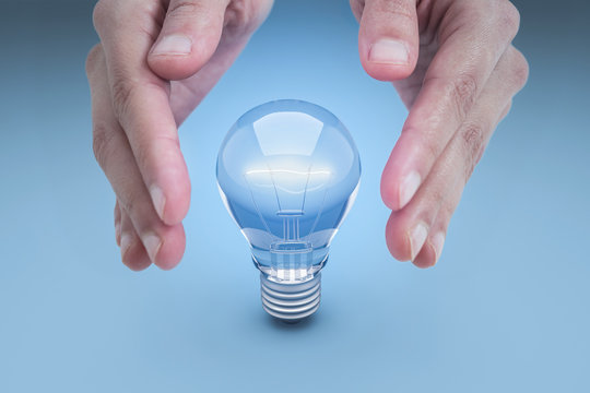 Light Bulb between hands.