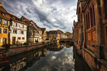 Colmar, Petit Venice, at dusk water canal and traditional colorful houses. Alsace, France