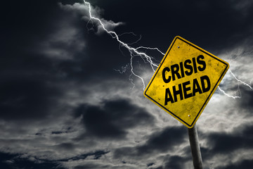 Crisis Ahead Sign With Stormy Background