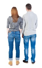 Back view of young embracing couple (man and woman) hug and look into the distance. beautiful friendly girl and guy together. Rear view people collection.  backside view of person.  Isolated over