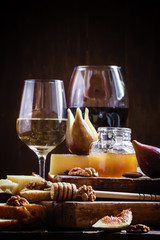 White and red wine, cheese, figs, nuts, honey and bread, vintage