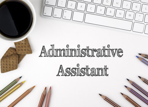 Administrative Assistant. On white office desk computer keyboard