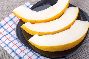 Dessert of sweet yellow melon slices