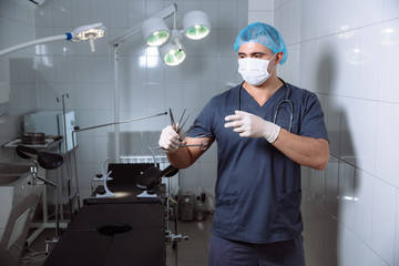 Doctor in operating room with medical tools. Concept of a hospital