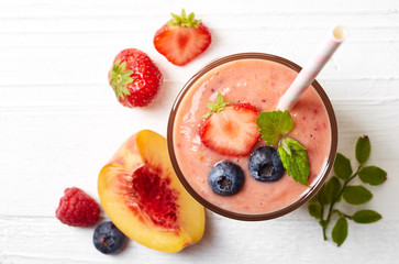 Glass of fruit and berry smoothie