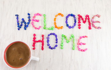 Welcome home note and cup of coffee