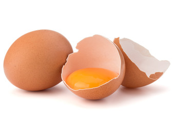 Broken egg in eggshell half and raw egg isolated on white backgr