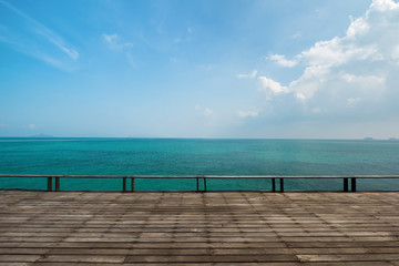 Wall Mural - Old wooden deck with the vast sea