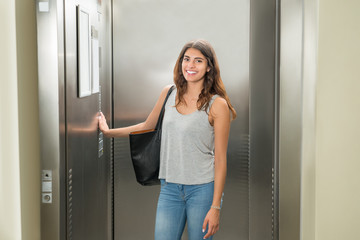 Woman Pressing Elevator Button