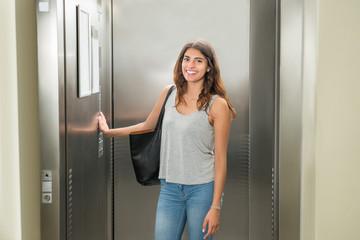 Woman Pressing Elevator Button