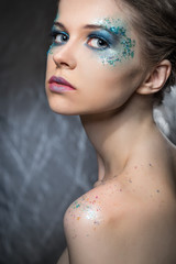 girl with bright make-up and sparkles