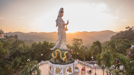 a style of Buddha with a naga over the head at wat Bangreang in PhangNga province.when  aerial photo by drone you can see Buddha statue,QuanYin and big pagoda on the hill top