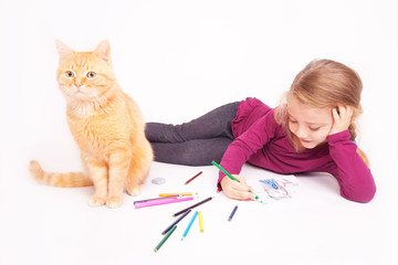 Little cute girl with colored pencils and red cat lying on the floor