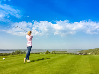 girl playing on a Golf course