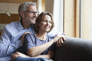 Smiling mature couple on couch