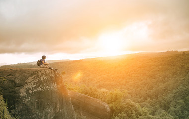 traveling woman relaxing trekking on rock cliff use for people l