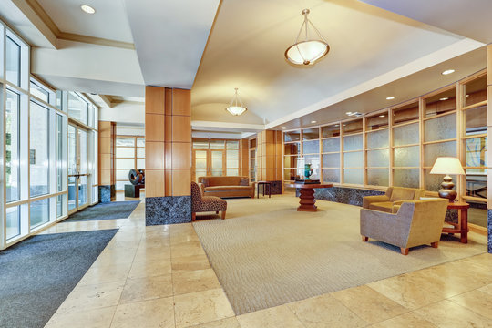 Building lobby with marble floor and furniture.