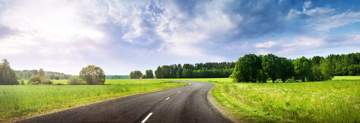 asphalt road panorama in countryside on beautiful evening