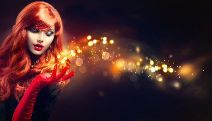 Beauty glamour woman with golden magic sparks in her hand