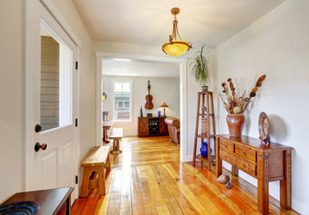 Nicely decorated entryway with vintage furniture.
