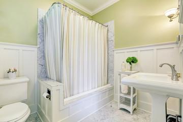 Lovely marble bathroom interior with full bath shower
