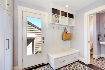 White hallway interior.  Storage cabinet with hangers