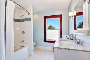 Lovely bathroom interior with single sink vanity and marble top