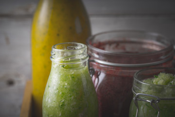 Jars with different smoothies close-up