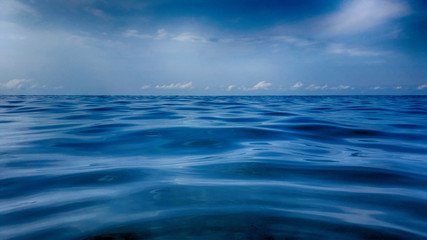 Surface of the warm sea with salt water