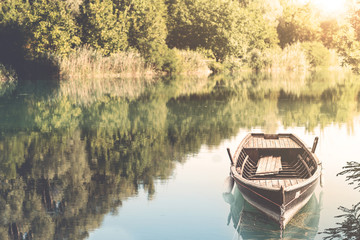 Canoe floating on the calm water