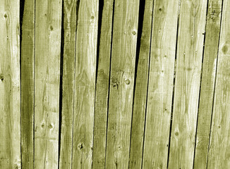 Grungy yellow wooden fence texture.