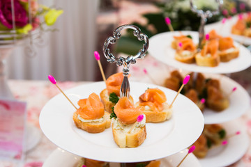 mini canapes with smoked salmon on table