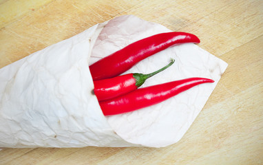 red hot chili peppers in paper bags