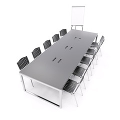 Empty conference table with flip chart