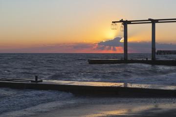 Beautiful sunset on the beach of the resort settlement Adler, Sochi, Krasnodar region, Russia