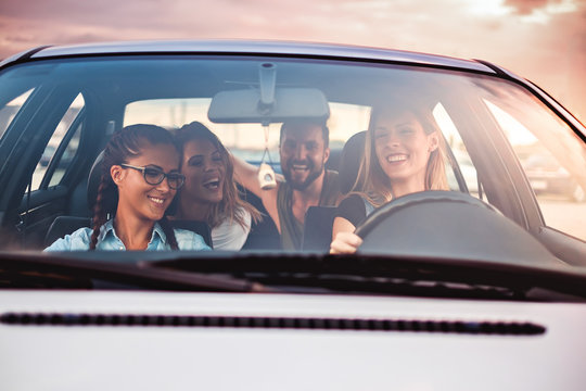 Group of friends having fun in the car