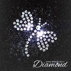 Butterfly Brilliant stones on black Denim Texture. Silver applique. Beautiful jewelry brooch with rhinestones. Ornament crystal precious, beadwork, embroidery. Fashion decor print.