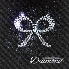 Brilliant stones Bow on black Denim Texture. Silver applique. Beautiful jewelry brooch with rhinestones. Ornament crystal precious, beadwork, embroidery. Fashion decor print.