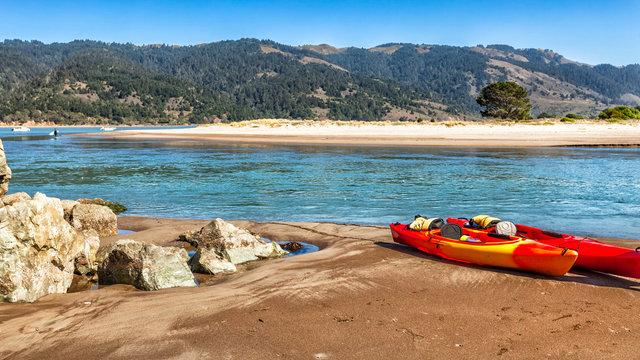 Colorful kayaks on a sandy river beach. Location:Bolinas near San Francisco